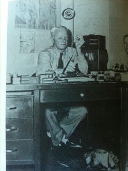 Nimitz at desk